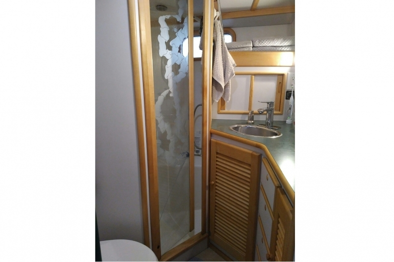 Head with Vacuflush and separate shower with etched glass door.