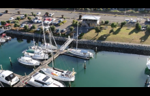 Berth is yacht with yellow kayak on deck