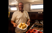 Learning to cook great food in our small galley.
