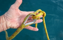 Doggie's 12m tow line is tied to this thimble on a pendant with a bowline