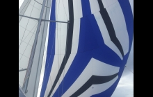 After our disasterous Spinnaker experience, we re-hoisted it briefly to work out all the kinks. Can you see the new tears?