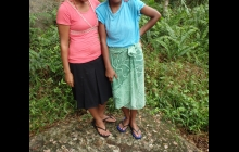 These 2 girls from the village kindly took us through the forest to the petroglyphs site. See the one at their feet?